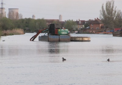 Dredging barge in the middle of the River Thames in Abingdon