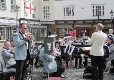Abbey Brass Band with Trumpet Soloist Standing and English Flag from Saint Georges Day behind