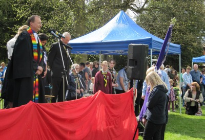Revd Richard Bittleston blesses a new scout flag