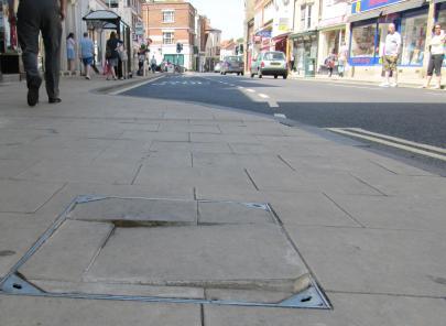 New Pavement on High Street broken