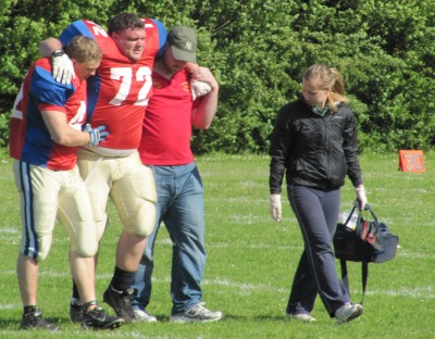 Oxford Saints player helped off