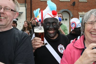 Man with black face from up north